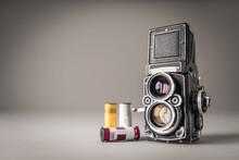 Studio Shot Of Vintage Camera And Film Rolls