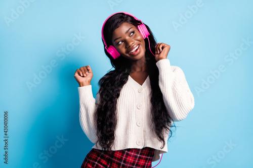 Photo of dreamy joyful afro american woman look empty space dance good music iso Wallpaper Mural