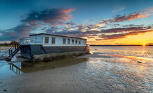 Dramatic Sunset Over A Houseboat In Bramble Bush Bay