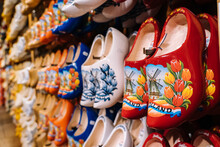 ZAANSE SCHANS, NETHERLANDS. November 2020. Dutch Traditional Colorful Handmade Wooden Shoes, Clogs With Colorful Paintings, Symbol Of Netherlands In Souvenir Shop In Dutch Village.