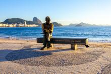 Rio De Janeiro, Brazil - January 8, 2014: Statue Of The Poet Carlos Drummond De Andrade On Copacabana Beach In Rio De Janeiro, Brazil.