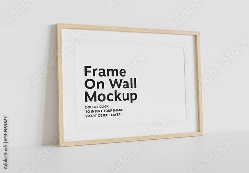 Fototapeta Wood Frame Mockup Leaning on White Wall obraz