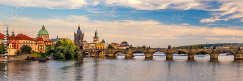 Scenic view on Vltava river and historical center of Prague, buildings and landmarks of old town, Prague, Czech Republic. Charles Bridge (Karluv Most) and Lesser Town Tower, Prague, Czechia - fototapety na wymiar