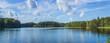 Leinwandbild Motiv Panoramic view of beautiful forest lake in Russia.