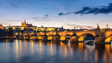 View Of Prague Castle And Charles Bridge At Sunset. Czechia