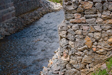 Bridge Abutment With Gabions. Gabion Wall Constructed Using Steel Wire Mesh Basket. Stone Walls, Protection From Backshore Erosion. Gabion And Rock Armour - Coastal And Waterways Protection.