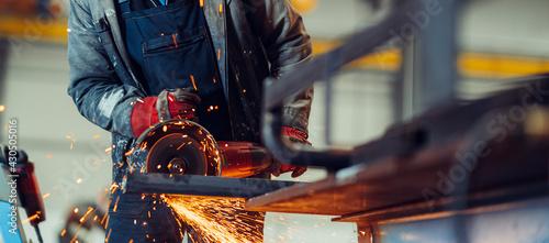Stampa su Tela Man working with electric grinder tool