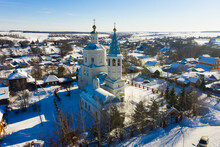 Aerial View Of Snow Covered Venyov Townscape With Architectural Ensemble Of Orthodox Church Of Our Lady Of Kazan And Epiphany Church In Winter, Tula Oblast, Russia