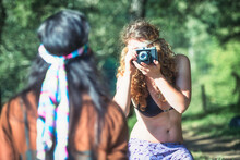 Hippie Style Girls Photograph Themselves With Vintage Camera
