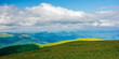 canvas print picture nature landscape of carpathian mountains. beautiful rolling scenery with grassy meadows in summer. clouds on the sky above the distant watershed ridge