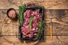 Fresh Raw Chicken Liver Offals Meat In A Wooden Tray. Wooden Background. Top View
