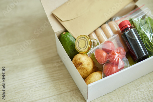 Fototapeta Food box meal kit of fresh ingredients and recipe blank order from a meal kit company obraz