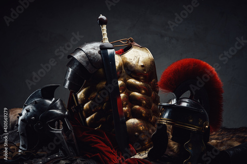 Canvas-taulu Gladius and bronze armor with two helmets