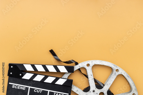 Motion picture film reel with movie clapper. Cinema concept Fotobehang
