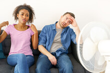 Stressed Couple Trying To Refresh From Hot Weather