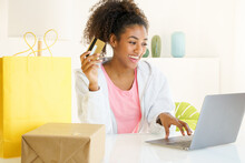 Smiling Young Black Woman With Credit Card Shopping From Home