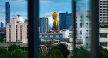 Large Golden Buddha (Phra Buddha Dhammakaya Thepmongkhon) With Pagoda Is A Public Placein In Traditional Community Phasi Charoen District,Bangkok,Thailand,The View Through The Window In The Building