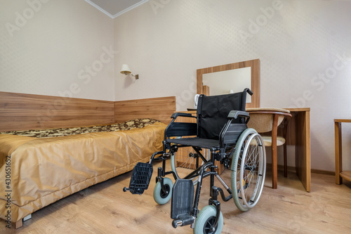 Interior of the bedroom with wheelchair in apartments or hotel for people with d Fotobehang