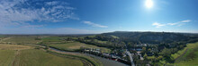 Aerial Panoramic View Of Amberley On The Banks Of The River Arun In West Sussex In A Scenic Position Within The South Downs.