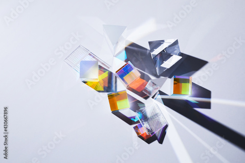 Fotografie, Obraz Geometric figures prisms with light diffraction of spectrum colors and reflectio