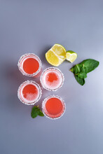 Set Of Four Pink Cocktails With Lime And Mint Top View