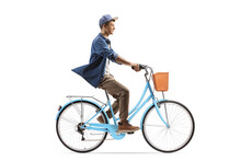 Full Length Profile Shot Of A Casual Guy Riding A City Bicycle