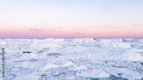 Climate Change - Iceberg and ice from glacier in arctic nature on Greenland