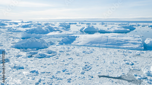 Fototapeta Climate Change. Iceberg afrom glacier in arctic nature landscape on Greenland. Icebergs in Ilulissat icefjord. Melting of glaciers and the Greenland ice sheet is a cause of sea levels rise obraz