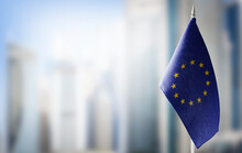 Small National Flags Of The European Union On A Light Blurry Background
