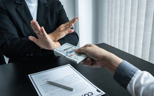 Business Woman Refusing And Don't Receive Money Banknote In Envelope Offer From Business People To Accept Agreement Contract Of Investment Deal