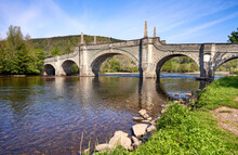 The Tay Bridge From The A Public Footpath On The Riverbank Of River Tay At Aberfeldy, Perthshire In The Scottish Highlands On A Sunny Spring Day.