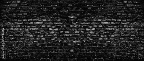Fotografija Black old shabby brick wall wide texture
