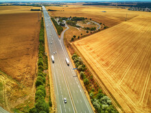 Aerial Drone View Of Beautiful French Countryside And Six-lane Motorway In France