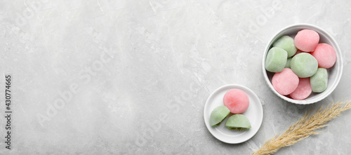 Obraz Delicious mochi and pampas grass on light grey marble table, flat lay with space for text. Traditional Japanese dessert - fototapety do salonu