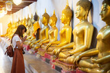 Happy Asian Woman Praying with Buddha in Temple