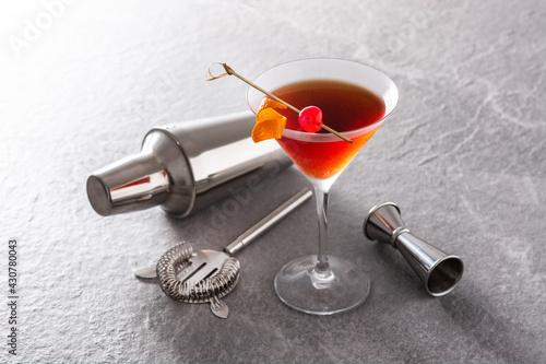 Fototapeta Traditional Manhattan cocktail with cherry on gray stone obraz