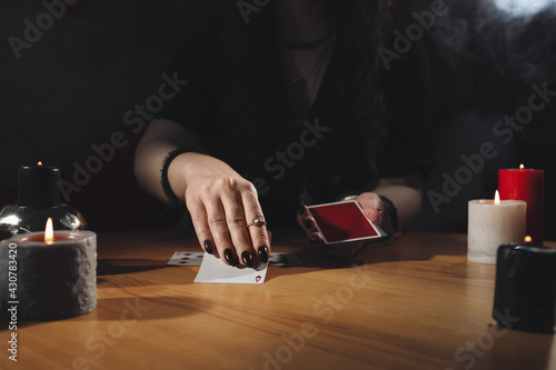 Soothsayer predicting future with cards at table indoors, closeup Fotobehang