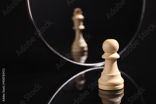 Fotografie, Obraz Pawn feeling itself like queen, chess piece in front of mirror