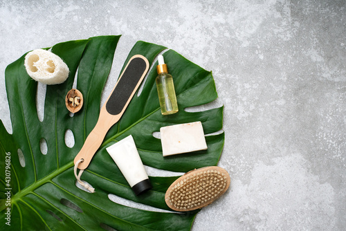 Obraz Spa composition with body care items and plants on a gray background. Top view - fototapety do salonu
