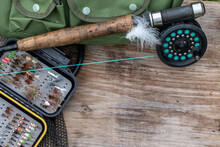 Fly Fishing Equipment On A Old Wooden Board Background, Negative Space