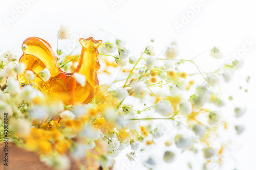 Billede på lærred lollipop honey cockerel on a stick among spring flowers