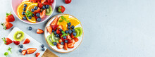Web Banner With Fresh Summer Salad Of Various Fruits And Berries. Kiwi, Orange, Strawberry And Blueberry On A Plate Decorated With Mint On A Table Top View, Free Space For Text