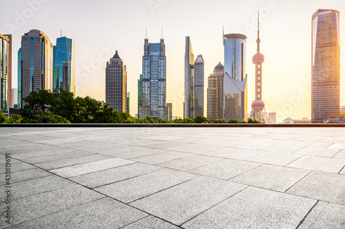 Architectural landscape and empty road at sunset in Shanghai, China Fotobehang