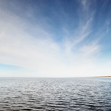 Panoramic View Of The Baltic Sea Shore On A Clear Sunny Day. Blue Sky, Cirrus Clouds. Idyllic Seascape. Nature, Environment, Weather, Vacations, Sailing, Cruise Concepts