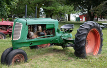 Old Green Tractor In Field