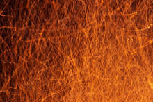 Incandescent Sparks From The Fire On A Black Background