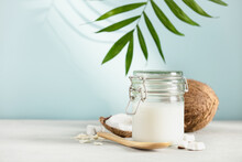 Coconut Oil In Jar With Fresh Coconut And Tropical Leaves, Spa Cosmetic And Food Ingredient, Copy Space