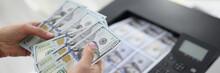 Woman Printing Dollar Bills On Printer Closeup