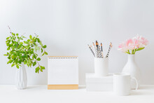 Home Interior With Decor Elements. Mockup White Desk Calendar And Pink Tulips In A Vase On A Light Background