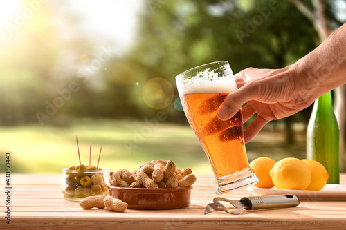 Fototapeta Man having a snack in countryside with beer in hand obraz